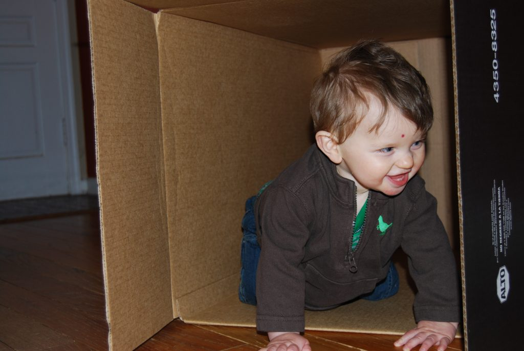 Having fun crawling in a box
