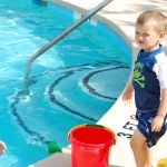 Toddler Swimming by pool