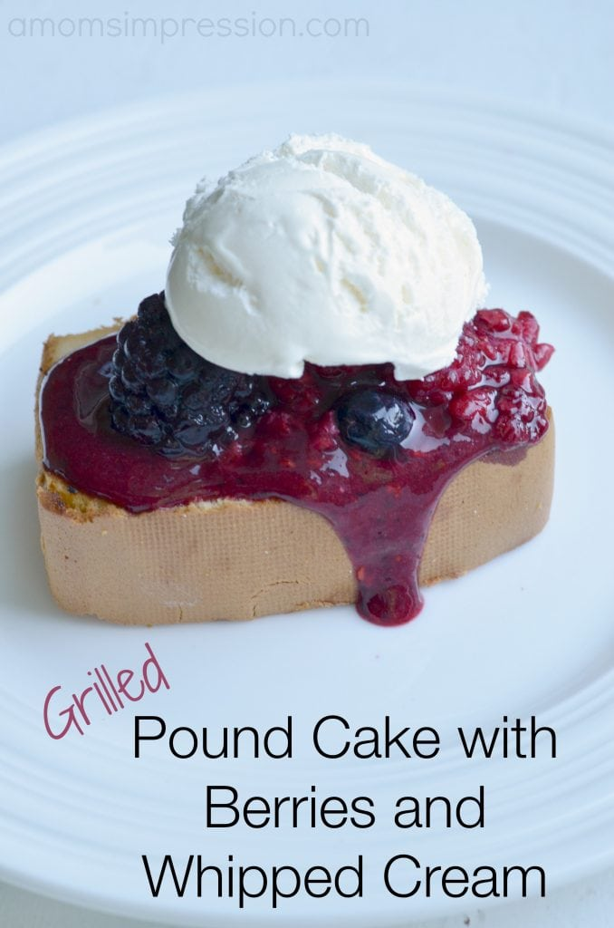 Grilled pound cake with berries and whipped cream sitting on a white plate