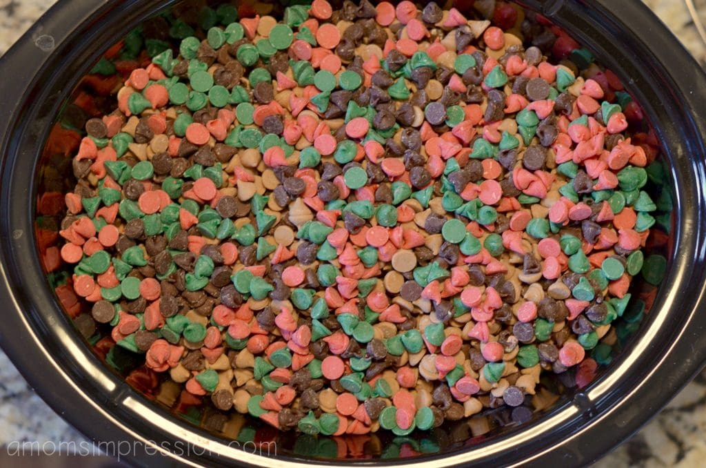 An assortment of colorful chocolate candy is perfect for this crockpot candy recipe