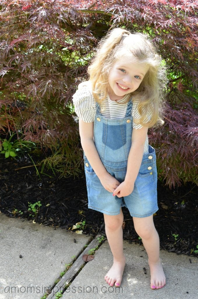 Girl in 7 for all mankind overalls