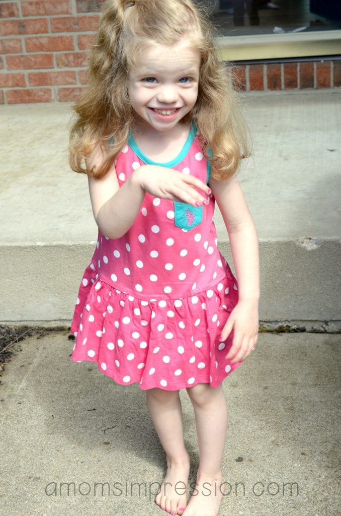 Girl in pink polka dot Ralph Lauren dress