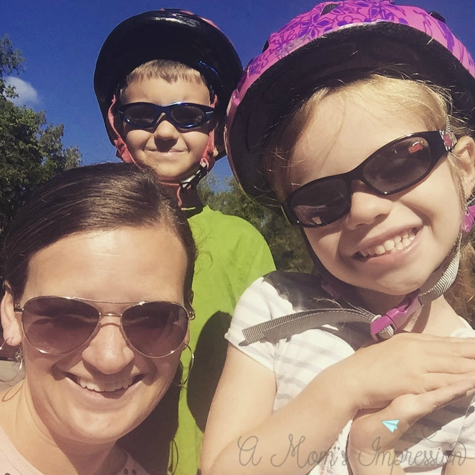 a mom and her two kids as Bike Riders