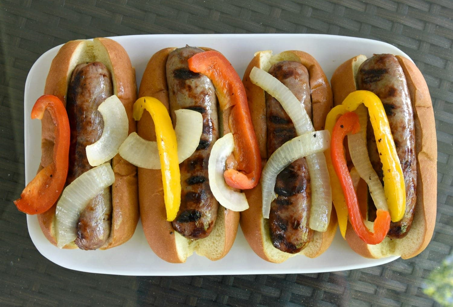Brats with peppers and onions