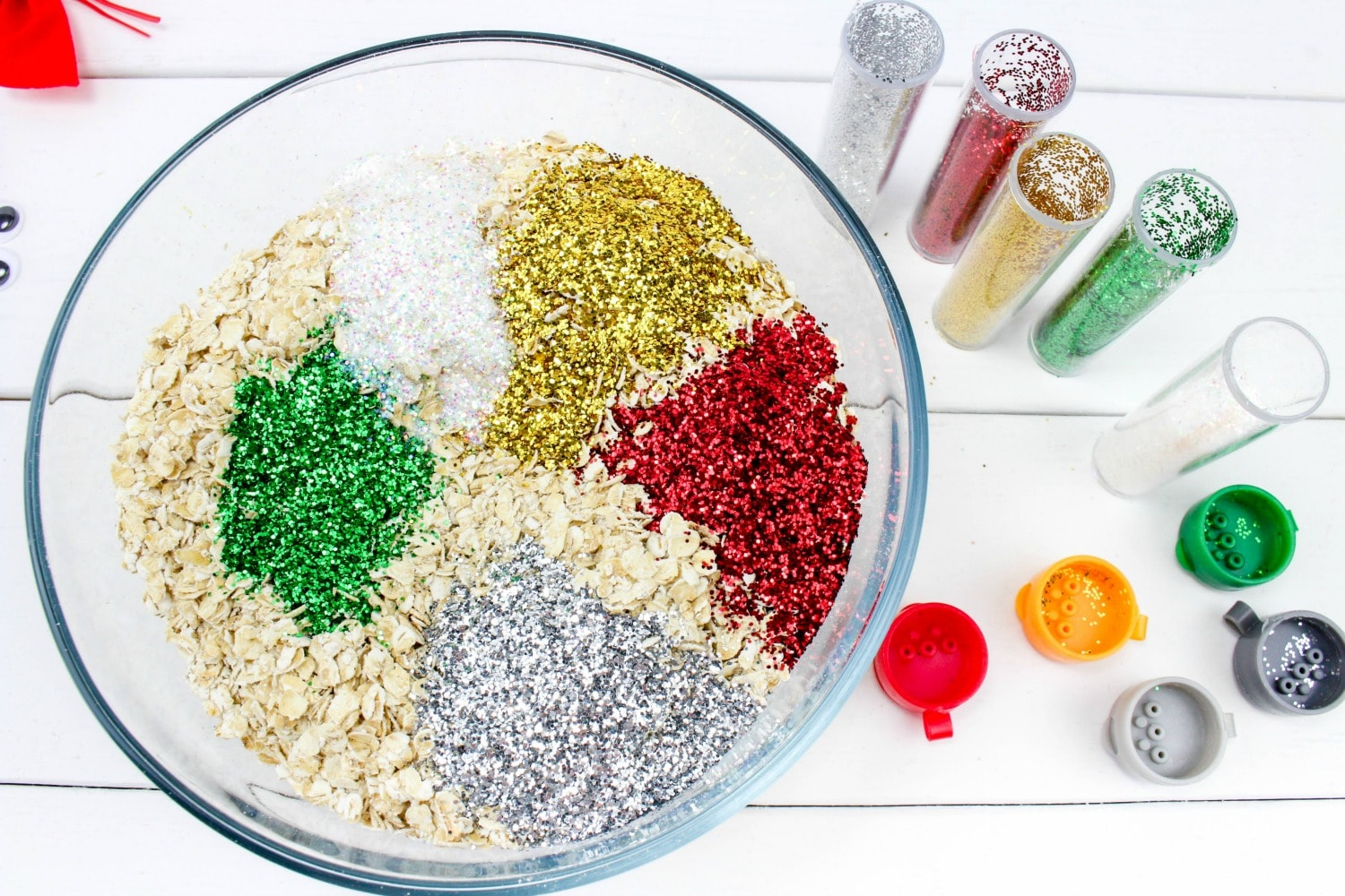 Reindeer Food being mixed in a bowl with all of the colored sparkle.