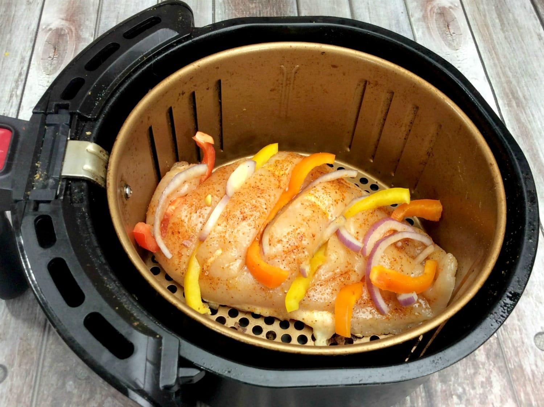 Chicken being made in an air fryer.