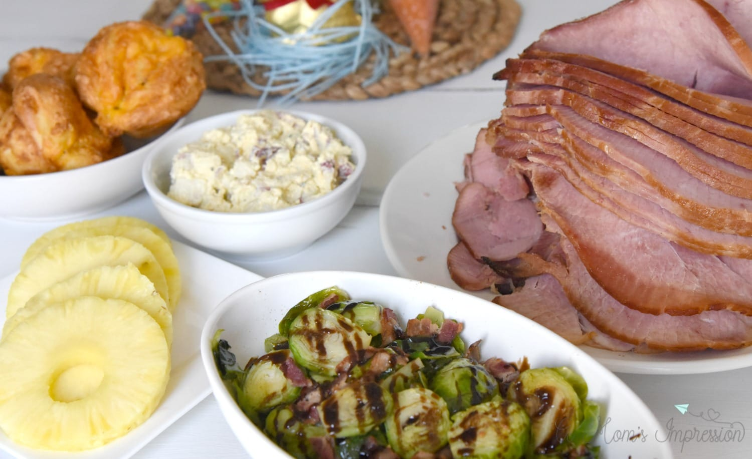 Easter Dinner with pineapple, brussels, ham and potato salad on the table.