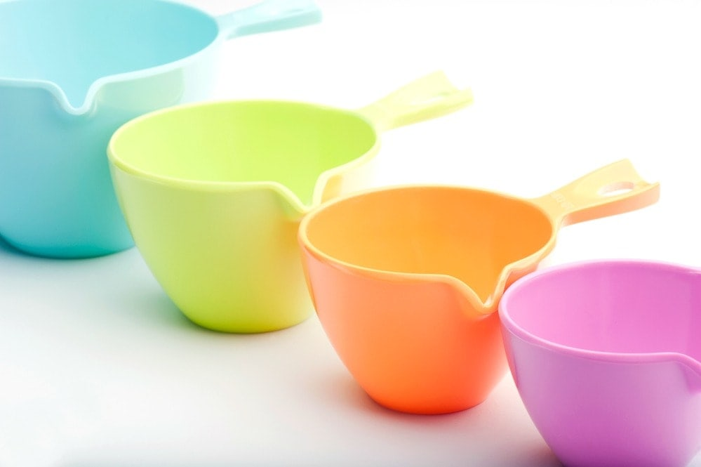 Learning how to find out how many cups in a quart with these brightly colored measuring cups