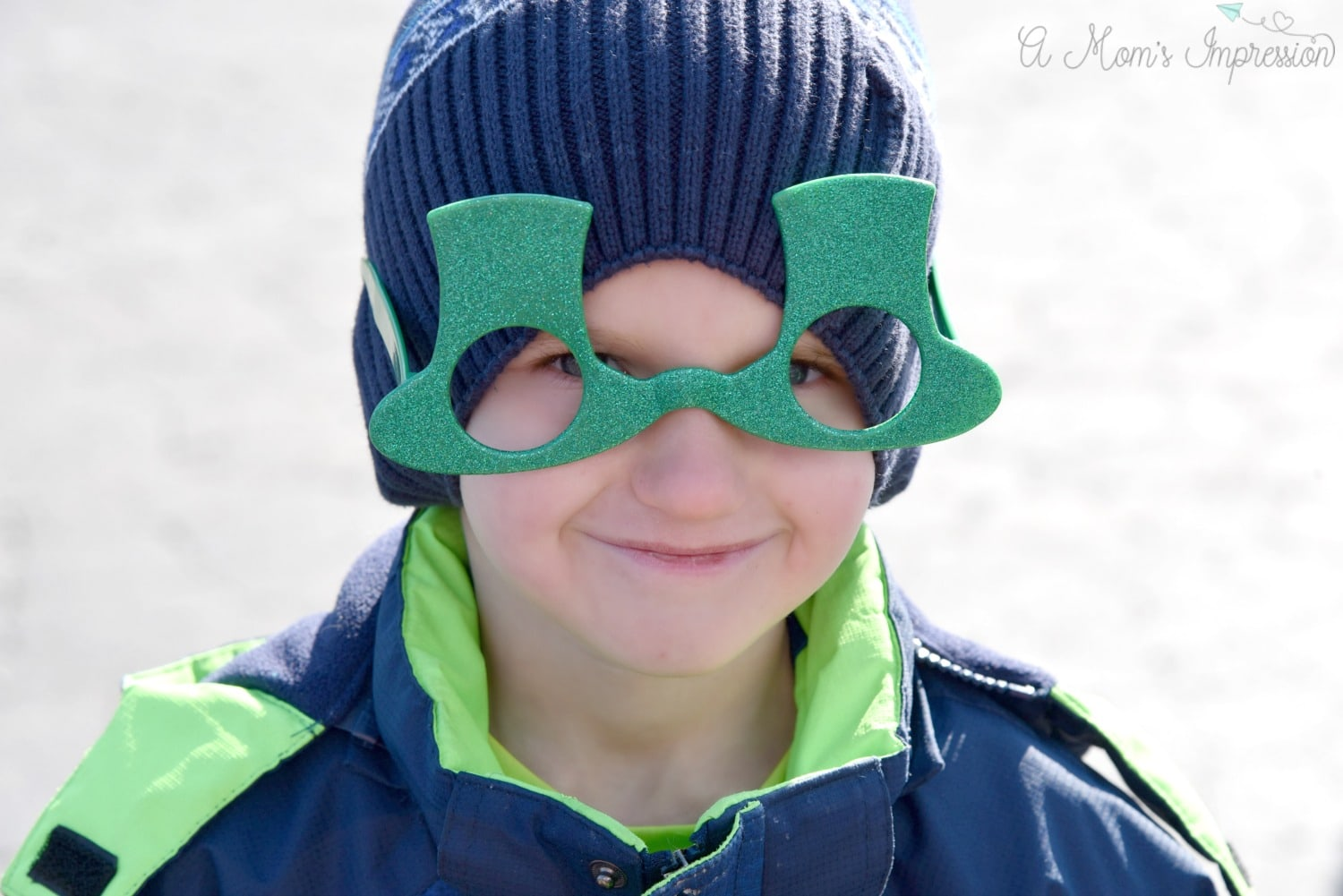 a boy with irish glasses on