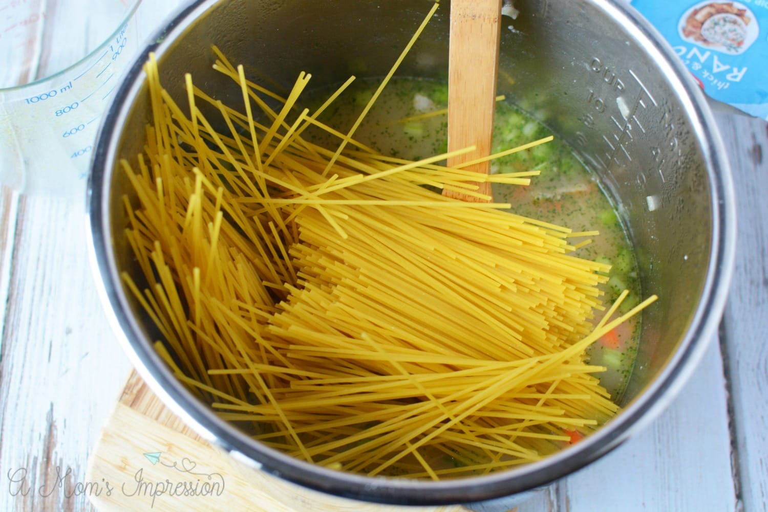 noodles being added to the crack chicken noodle soup