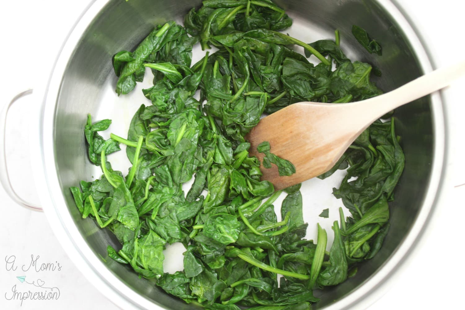 Wilting spinach for a chicken and spinach recipe