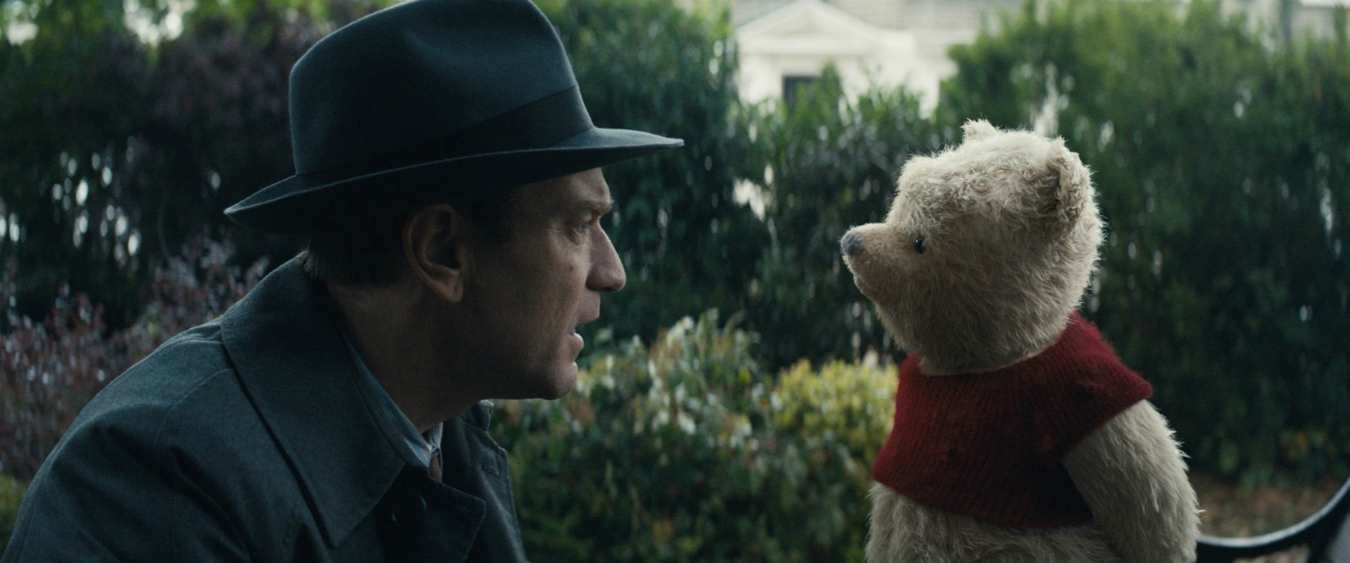 Pooh Bear and Christopher Robin talking