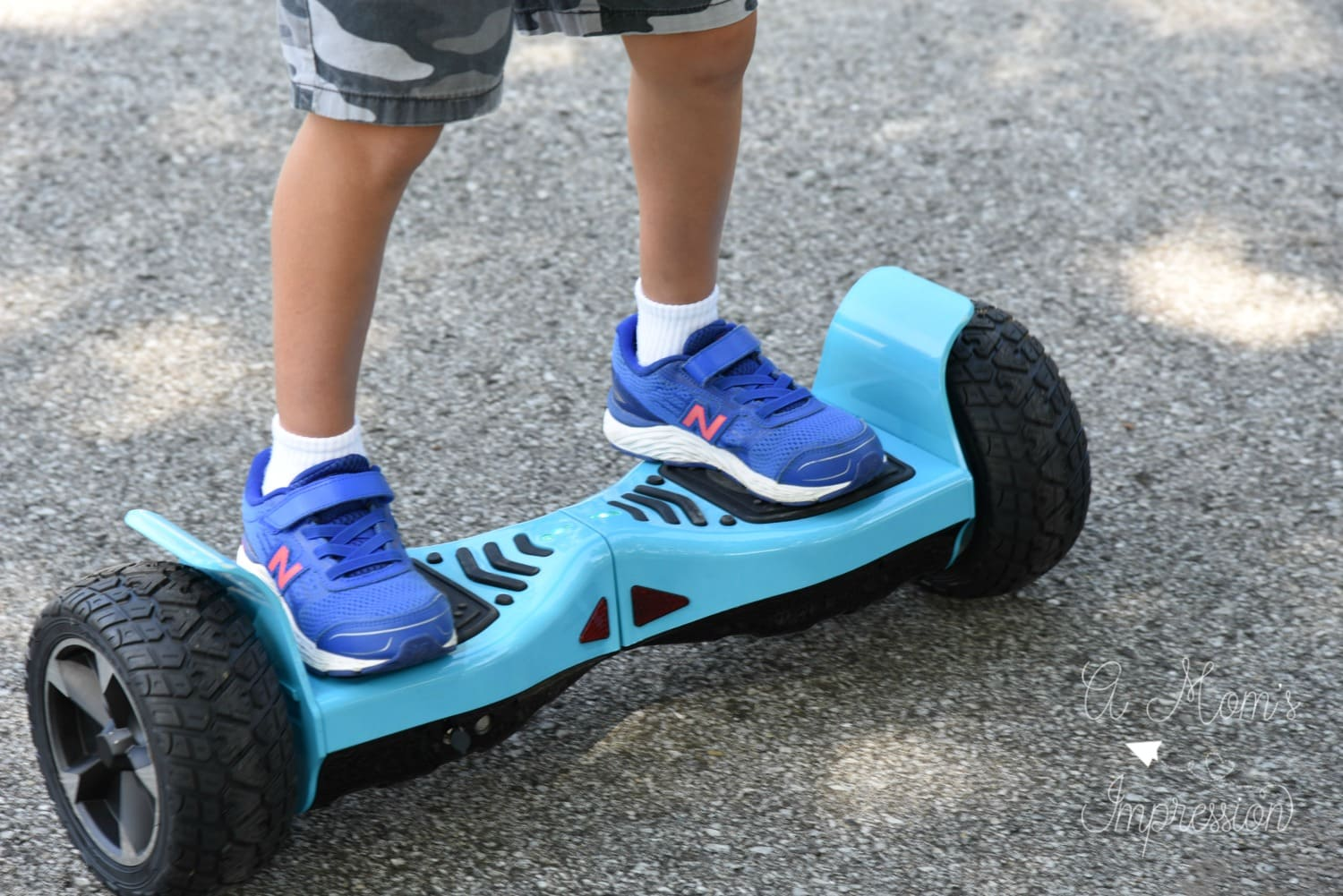 kid riding a hoverboard