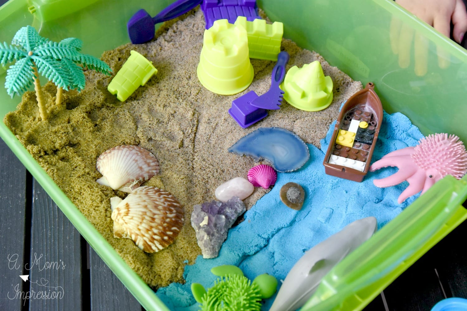 themed beach sensory bin