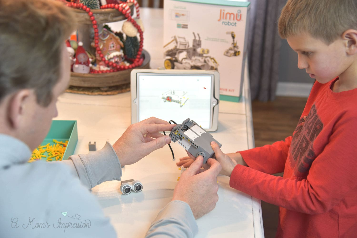 dad and son building robot