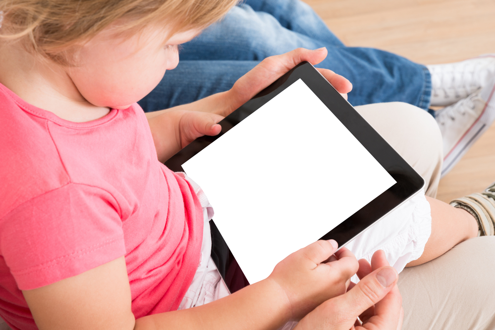 Small Girl Using Digital Tablet