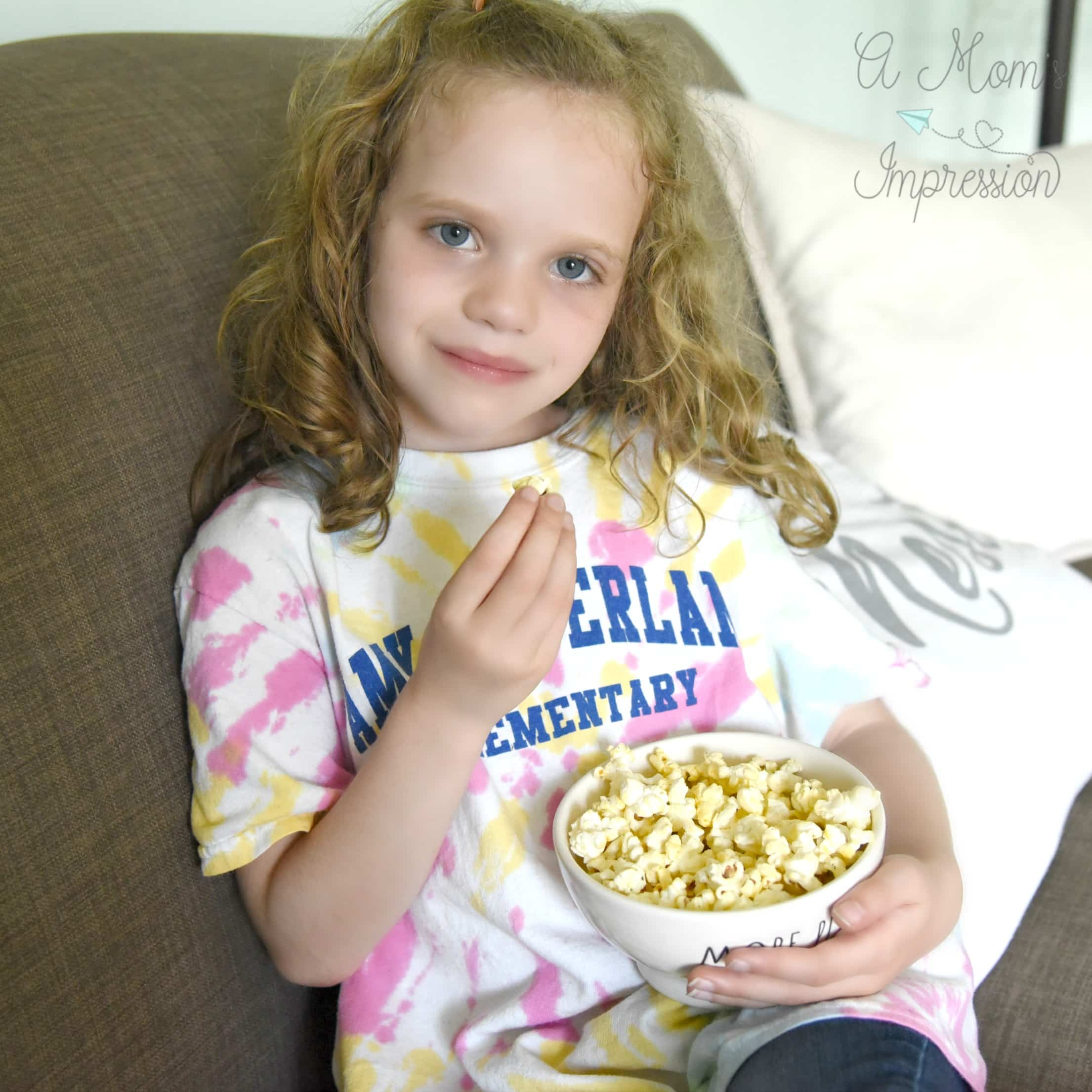 enjoying popcorn