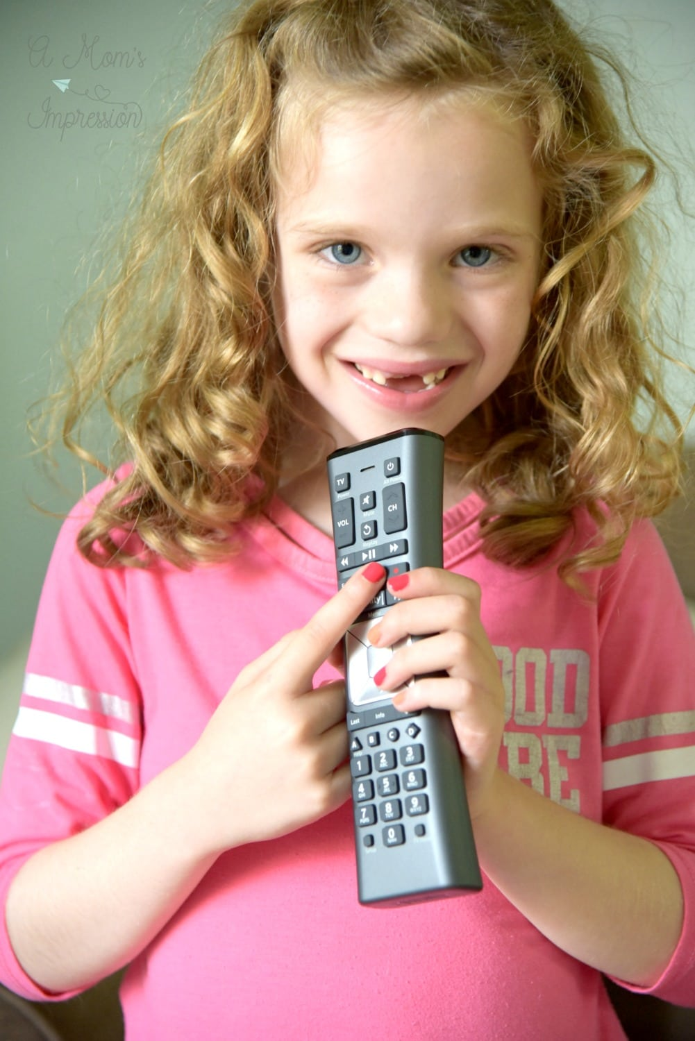 child holding a Xfinity remote