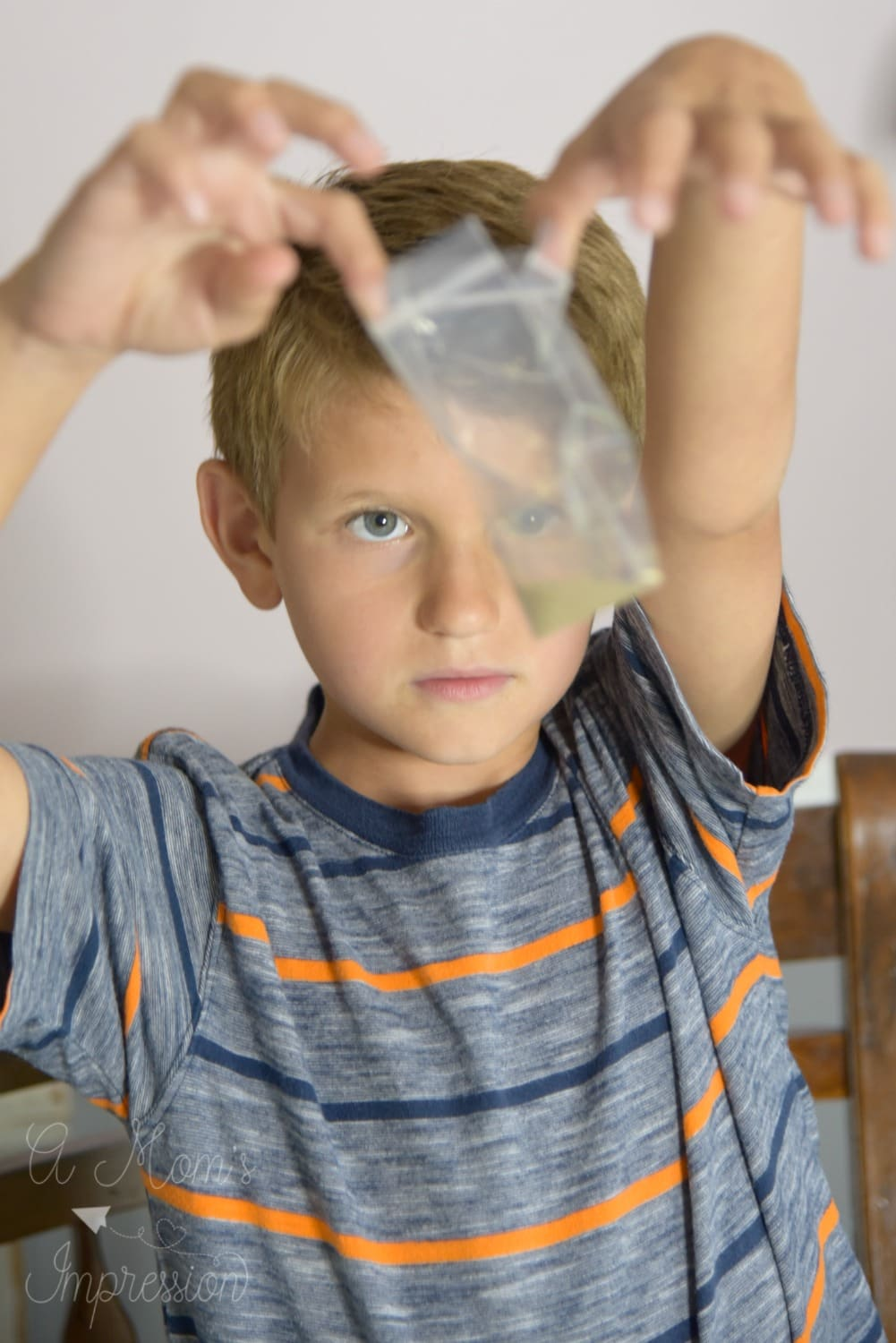 a boy looking at a science experiment