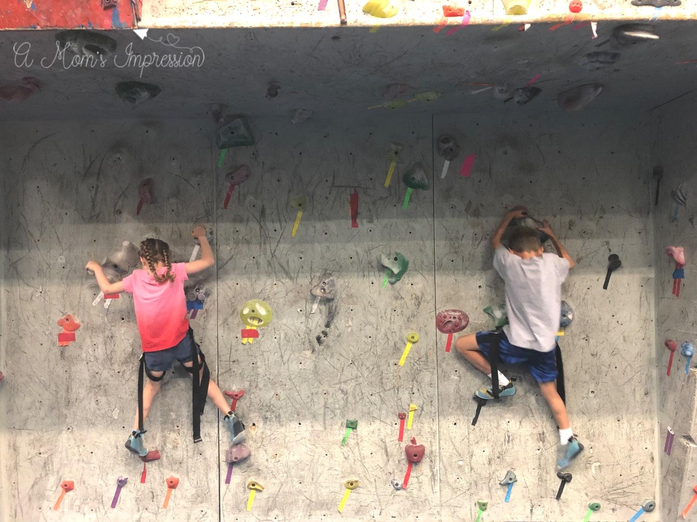 two kids climbing an indoor Climbing Wall