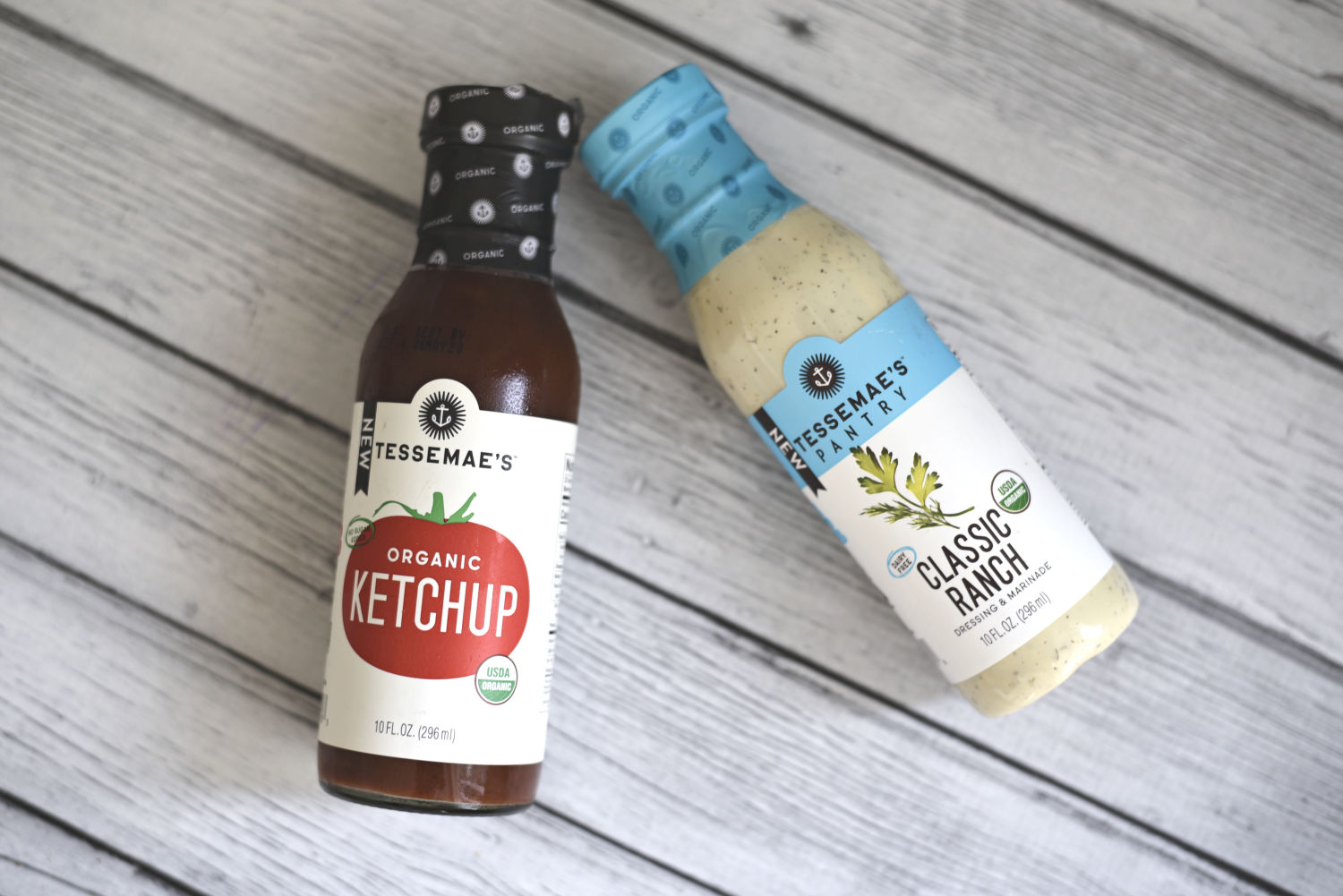 bottles of Tessemaes ketchup and ranch dressing