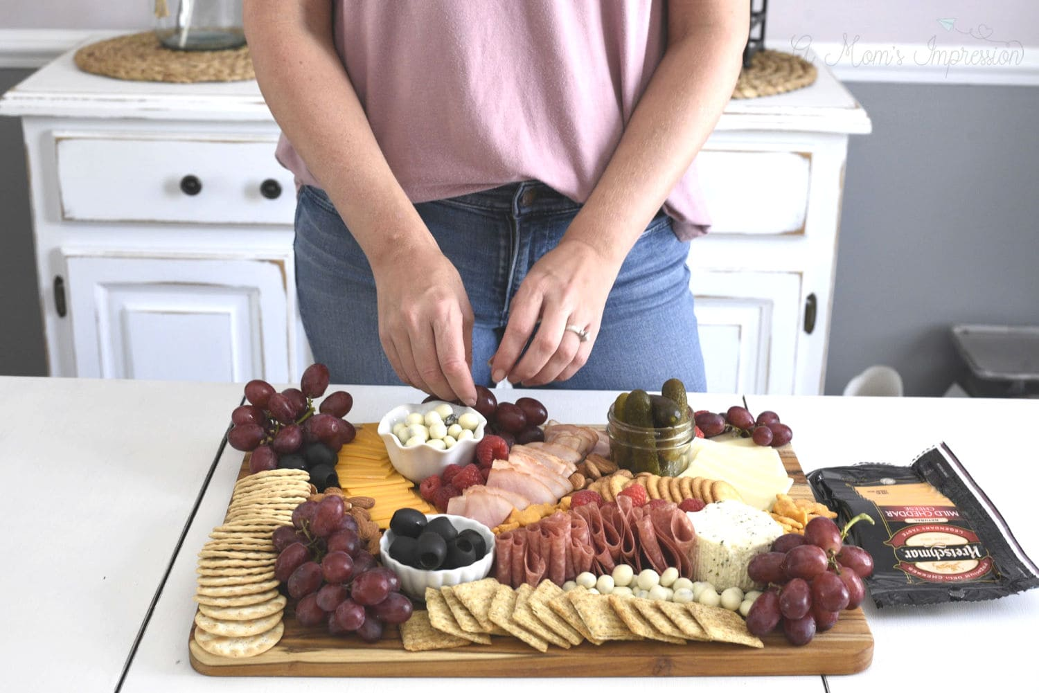 a person making a charcuterie board