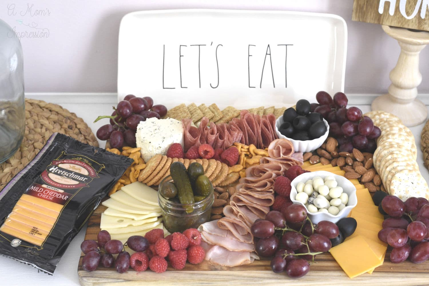 A display charcuterie board on a table with cheese