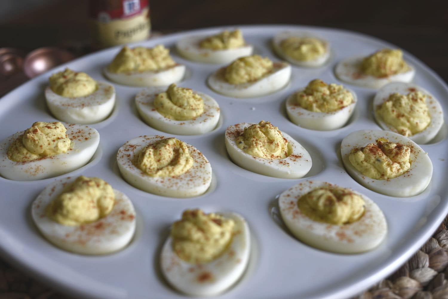 a plate of deviled eggs sitting on a table