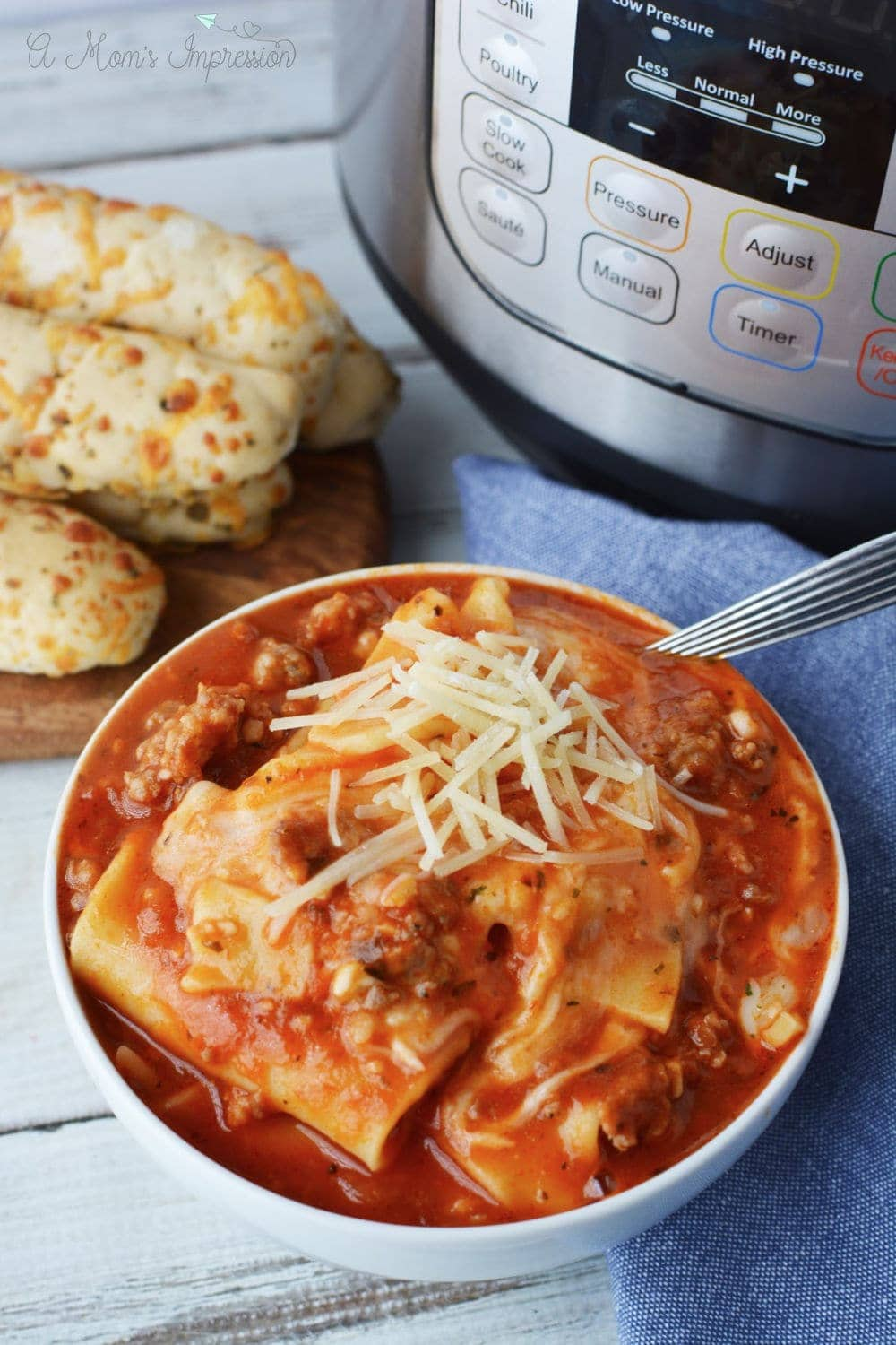 a bowl of Lazy Lasagna sitting in front of a pressure cooker