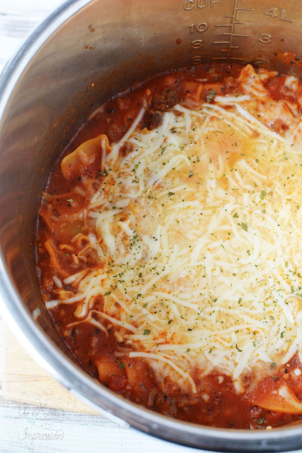 lasagna soup in a pressure cooker pot topped with cheese