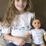 a girl wearing matching shirts with her doll, Joss