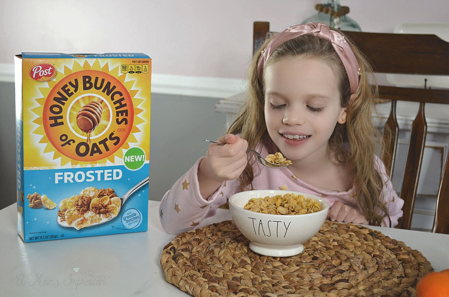 a child eating honey bunches of oats