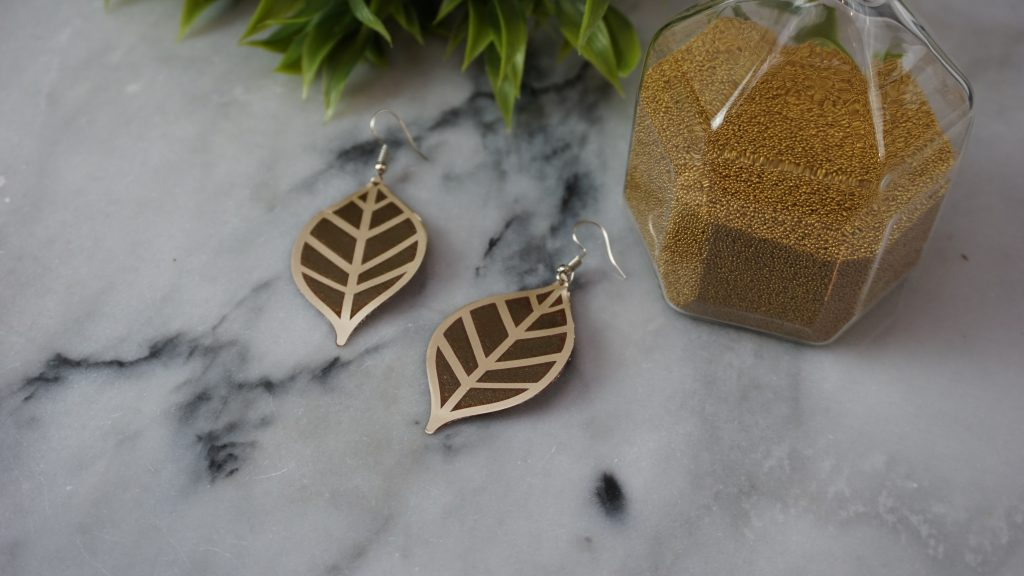 Cricut earrings laying on a table