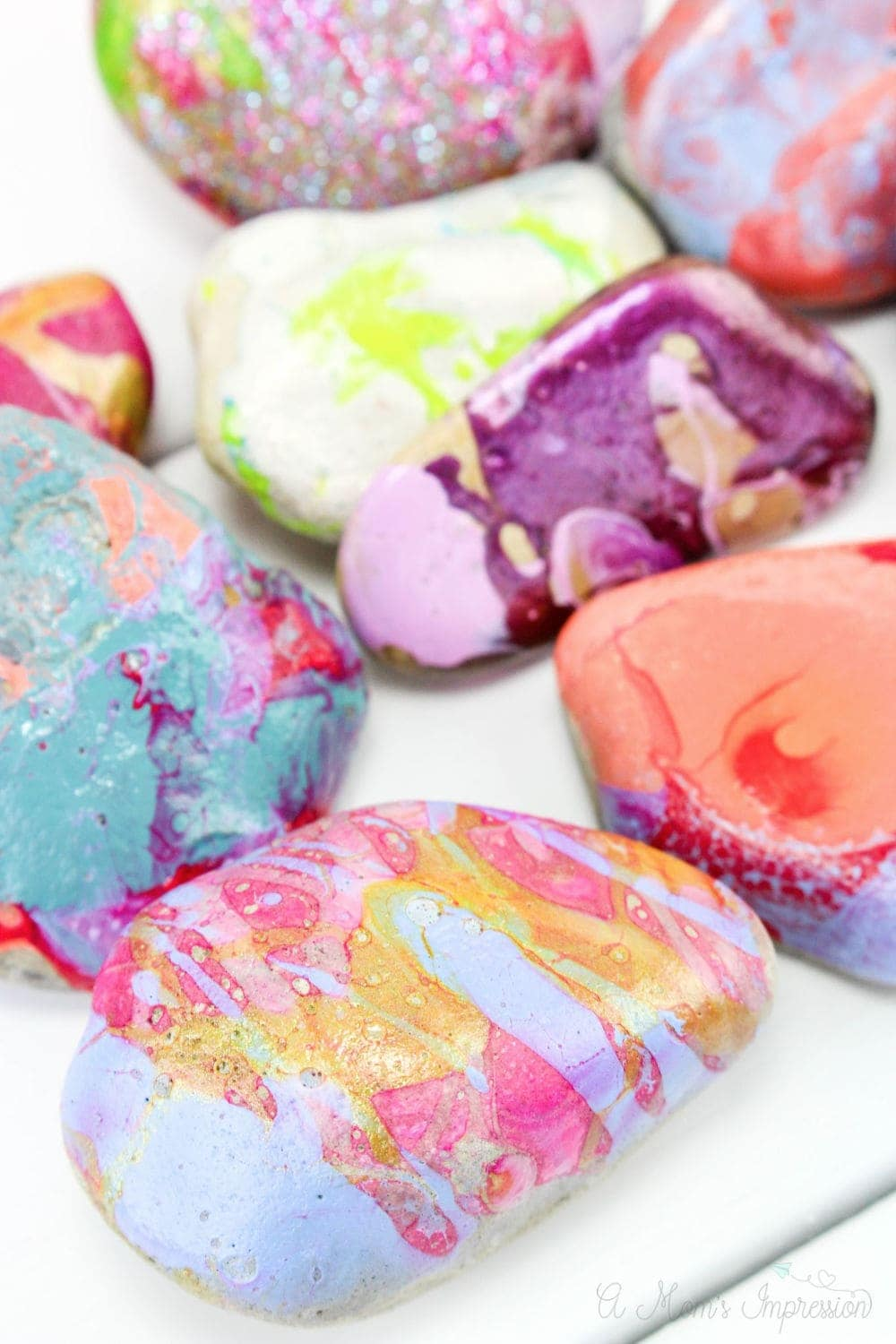marbled painted rocks on display