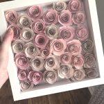 a frame full of paper roses