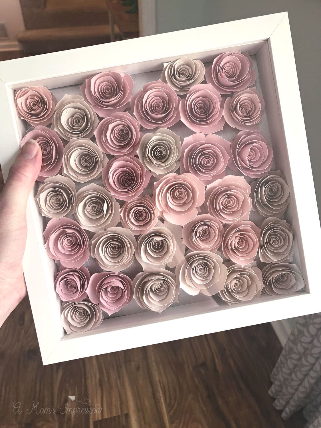 a frame full of paper roses
