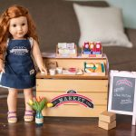 a doll standing by a city market play toy