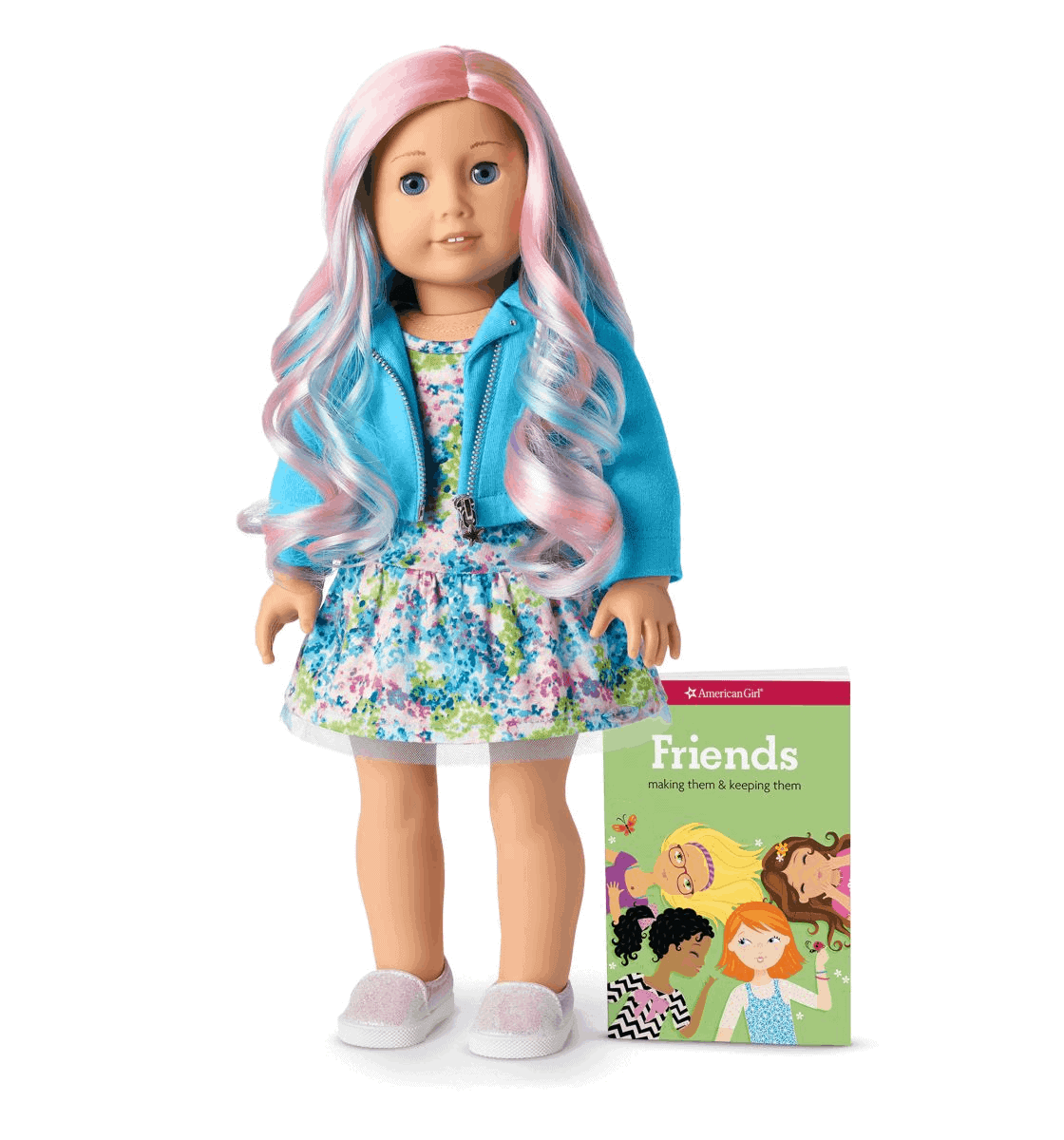 a doll with pink and blue hair standing next to a Friends book