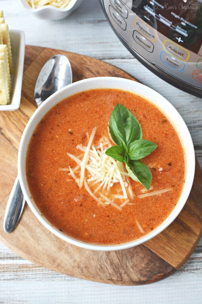 Instant Pot Tomato Soup Recipe uses canned tomatoes, half and half, onions and other spices.