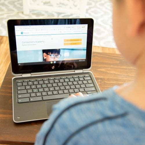 A child using the computer for online school