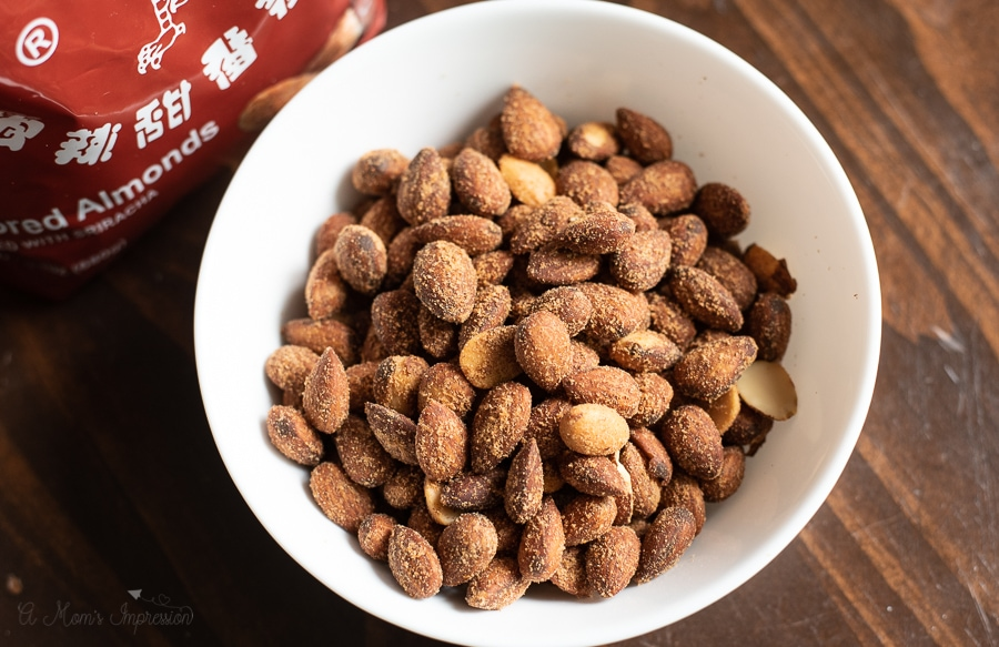 a bowl of spicy sriracha almonds