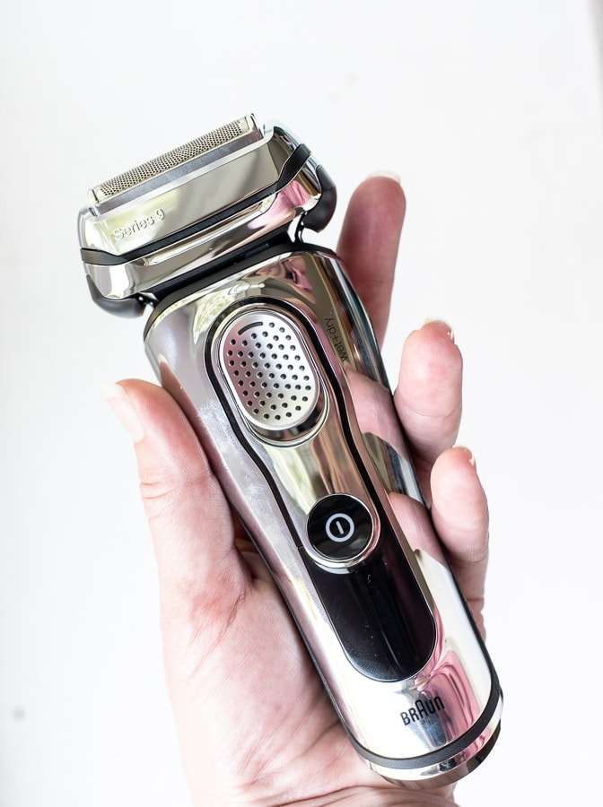 someone holding up a Braun-Mens shaver