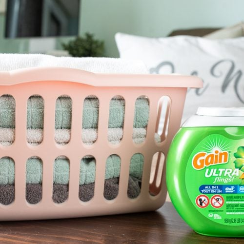 Gain Flings next to a laundry basket