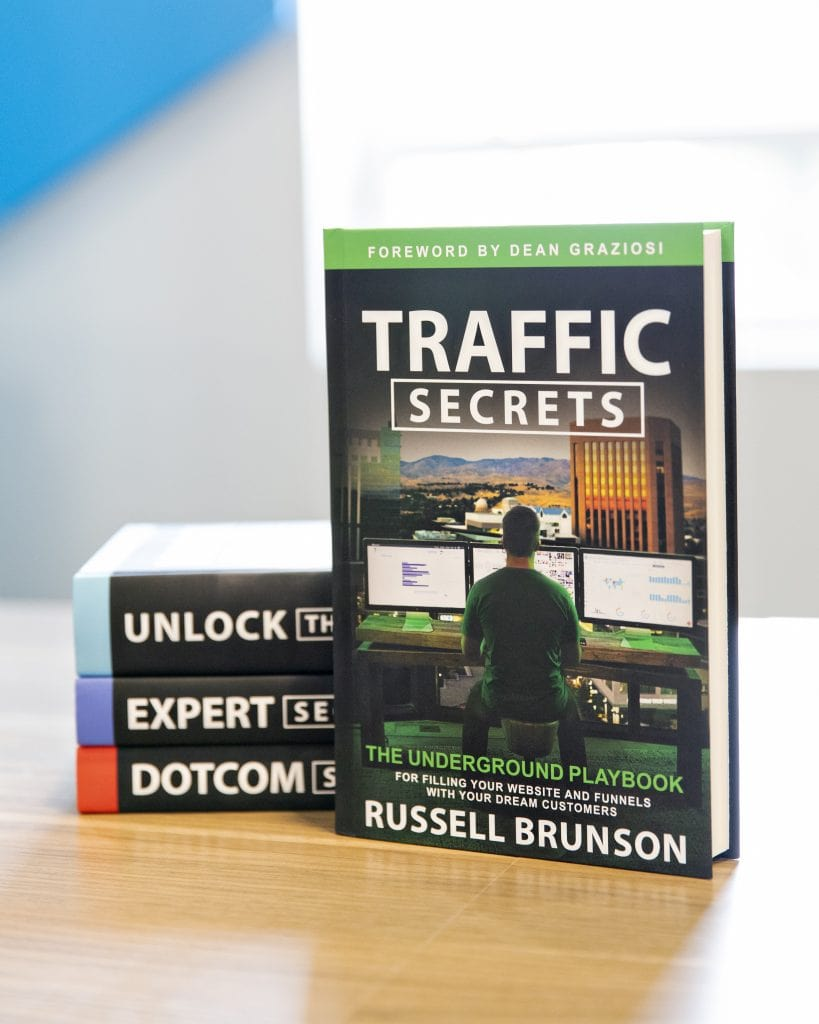 Traffic Secrets Book on a table