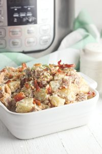 Instant Pot Potato Salad made with sour cream, cheese and bacon in your pressure cooker.