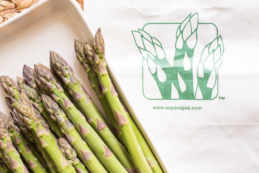 a plate of asparagus next to a Michigan Asparagus bag