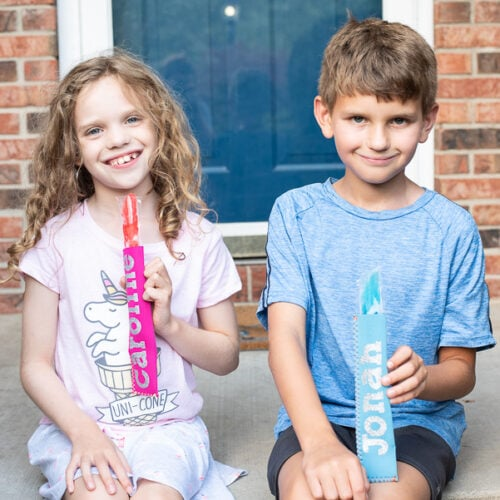 kids eating ice pops on the front porch