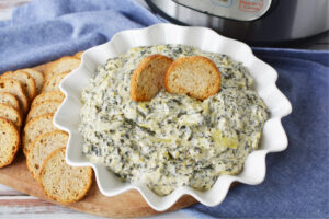Instant Pot Spinach Artichoke Dip is a quick and easy appetizer made in your pressure cooker.