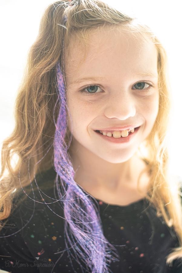 Hair extensions in a tween girls hair