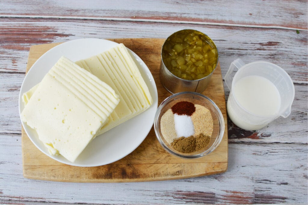 Instant Pot Queso Ingredients include green chilis, white american cheese and butter.